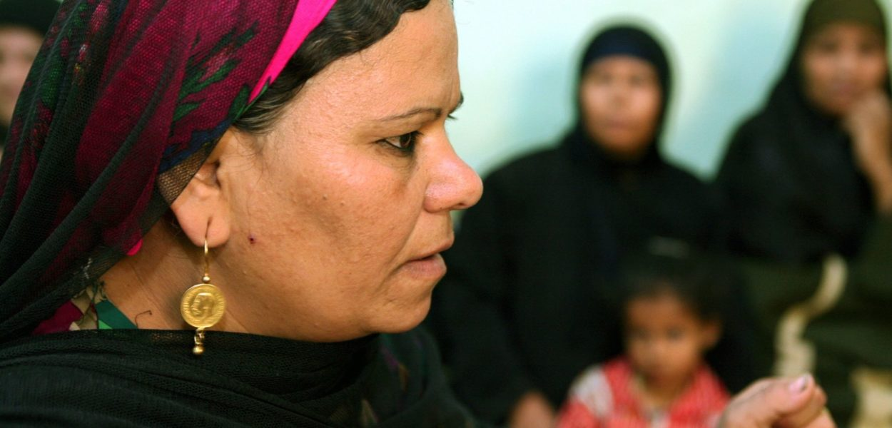 A woman educates a group of women on the dangers of FGM in Minia